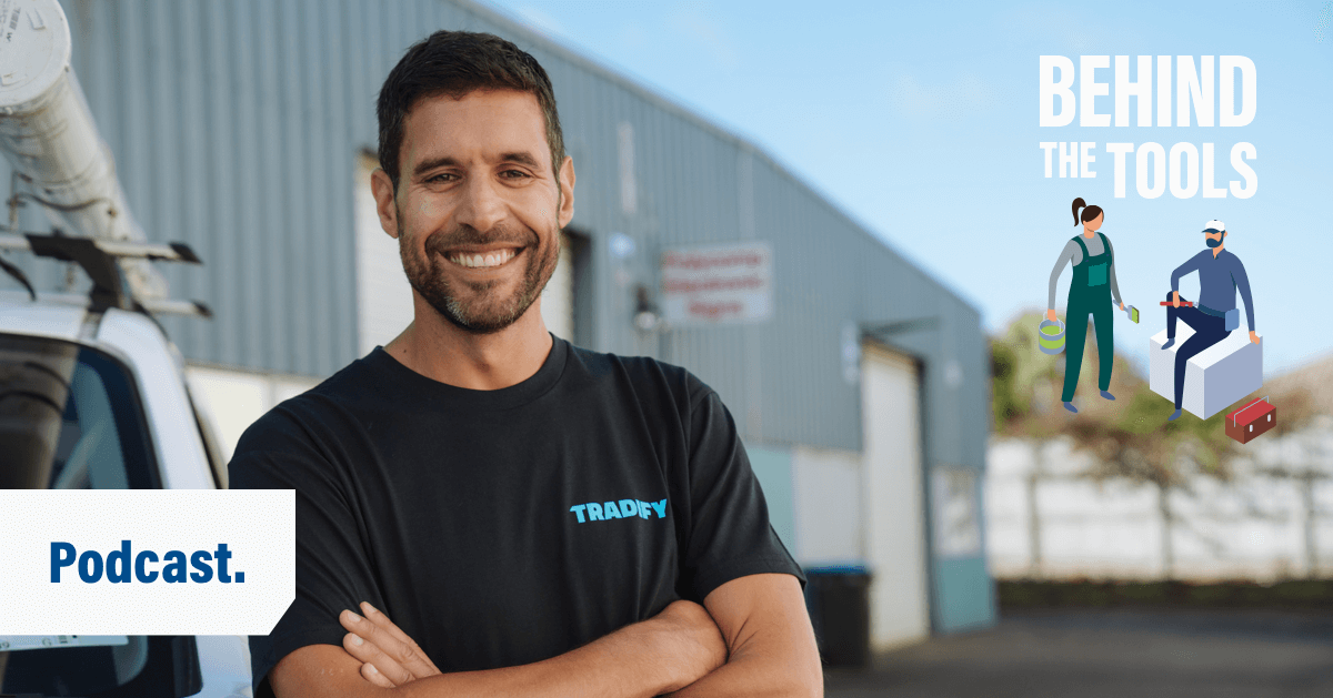 Tradify CEO Michael Steckler smiles with his arms folded