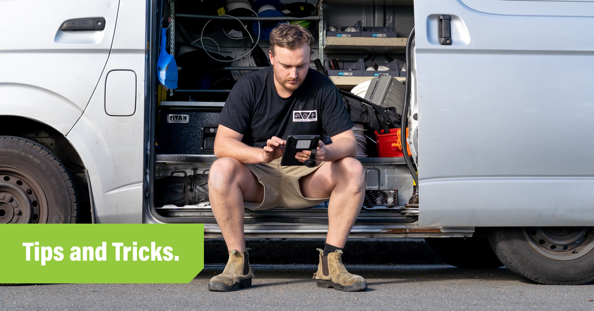 Tradesperson in their van working in an ipad