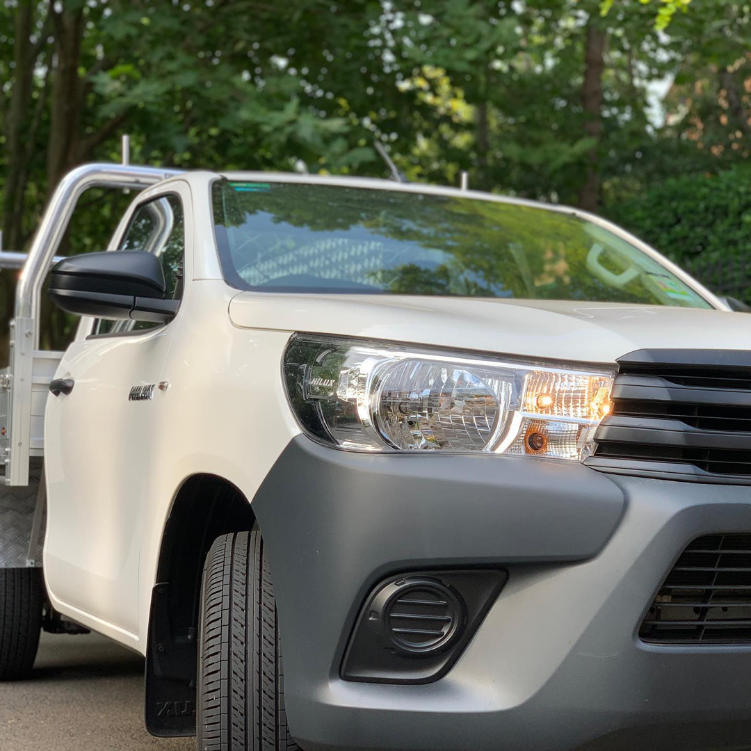 white hilux shot at a low angle