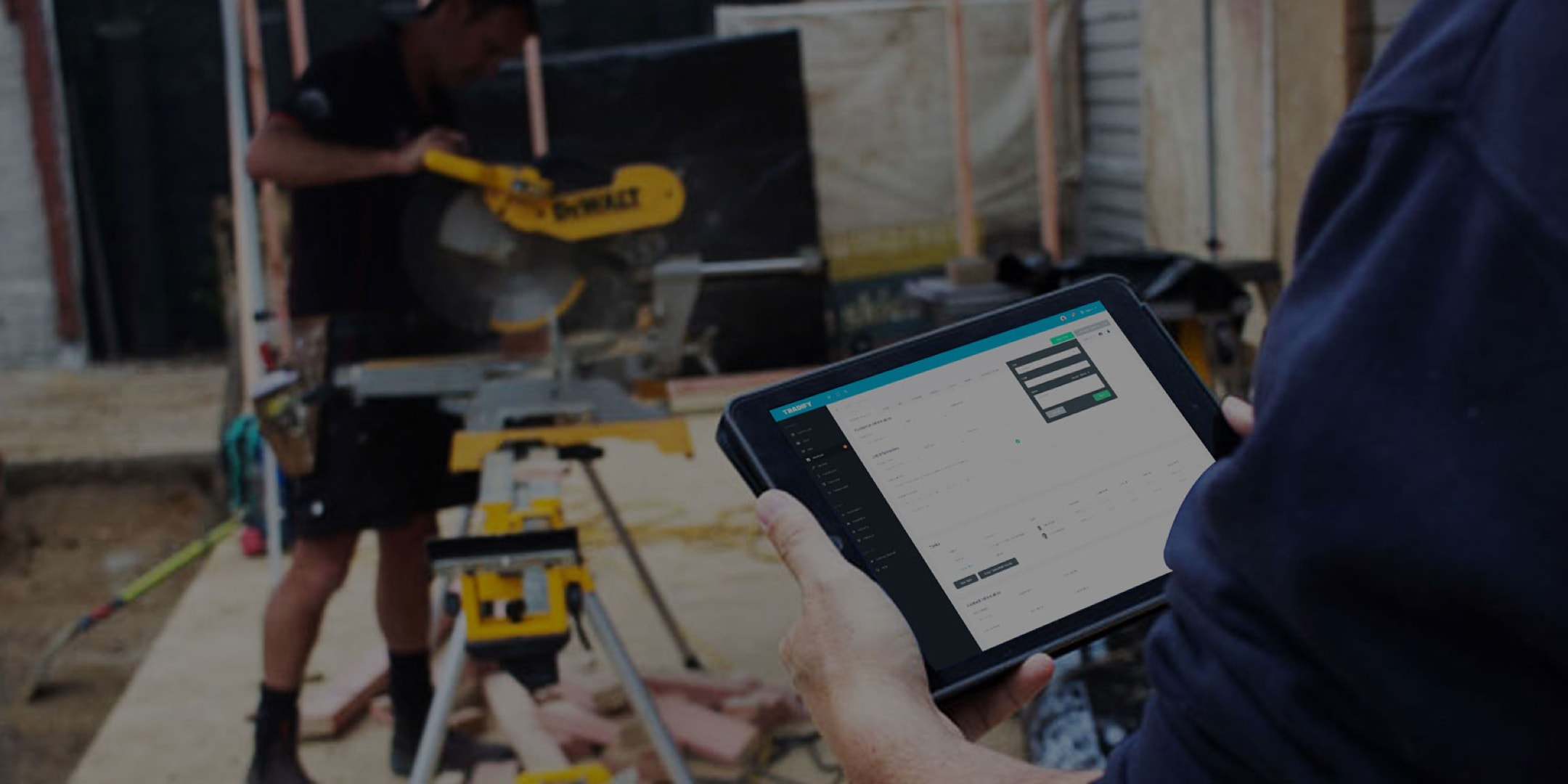A tradesperson uses Tradify on a job site from an ipad