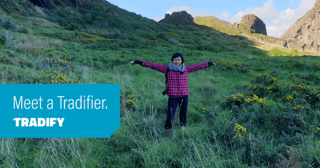 Meet a Tradifier heading laid over a photo of Gisselle standing in a field with arms outstretched